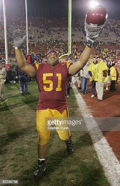 Offensive guard Fred Matua of the University of Southern California Trojans celebrates after defeating the University of Notre Dame Fighting Irish on...