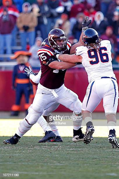 Offensive guard Greg Nosal of the Virginia Tech Hokies blocks defensive tackle Nick Jenkins of the Virginia Cavaliers at Lane Stadium on November 27...