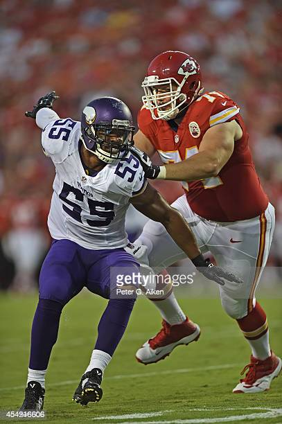 Offensive guard Jeff Linkenbach of the Kansas City Chiefs blocks linebacker Anthony Barr of the Minnesota Vikings during the first half on August 23...