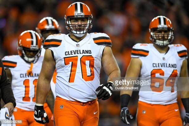Offensive guard Kevin Zeitler of the Cleveland Browns stands not he field with teammates in the first quarter of a game against the Denver Broncos at...