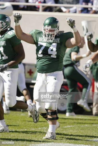 Offensive guard Kyle Cook of the Michigan State University Spartans celebrates during the game against the University of Illinois Fighting Illini at...