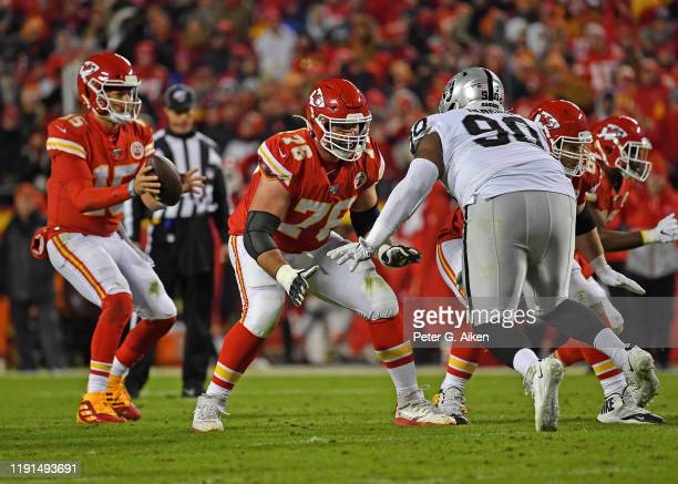 Offensive guard Laurent Duvernay-Tardif of the Kansas City Chiefs gets set to block defensive tackle Johnathan Hankins of the Oakland Raiders during...