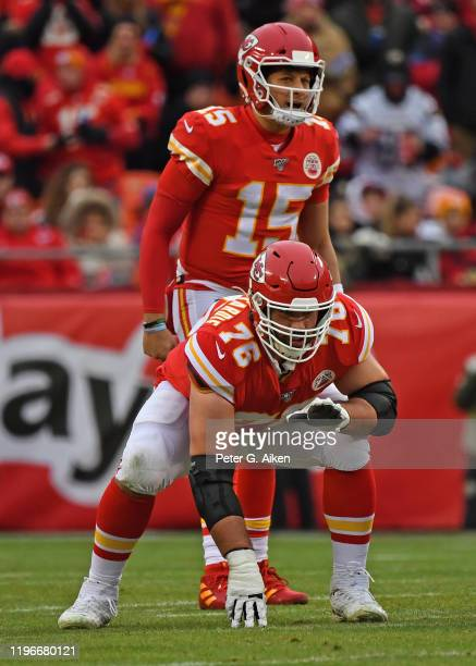 Offensive guard Laurent DuvernayTardif of the Kansas City Chiefs gets set on the line of scrimmage as quarterback Patrick Mahomes of the Kansas City...