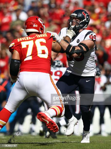 Offensive guard Laurent DuvernayTardif of the Kansas City Chiefs battles defensive end JJ Watt of the Houston Texans during the game at Arrowhead...