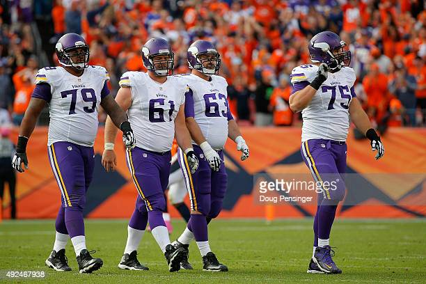 Offensive guard Michael Harris center Joe Berger guard Brandon Fusco and tackle Matt Kalil of the Minnesota Vikings head for the bench as they face...
