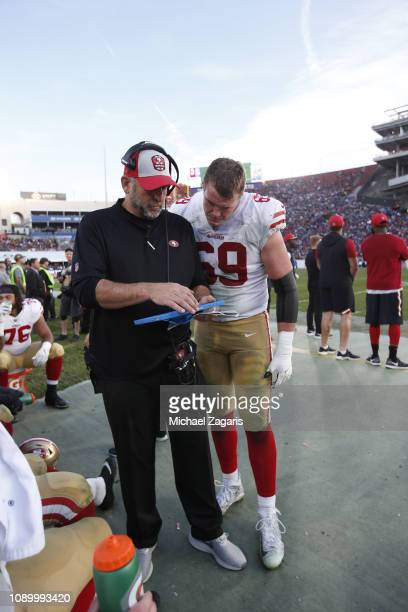 Offensive Line Coach John Benton and Mike McGlinchey of the San Francisco 49ers talk on the sideline during the game against the Los Angeles Rams at...