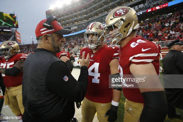 Offensive Line Coach John Benton Joe Staley and Mike McGlinchey of the San Francisco 49ers talk on the sideline during the game against the Seattle...