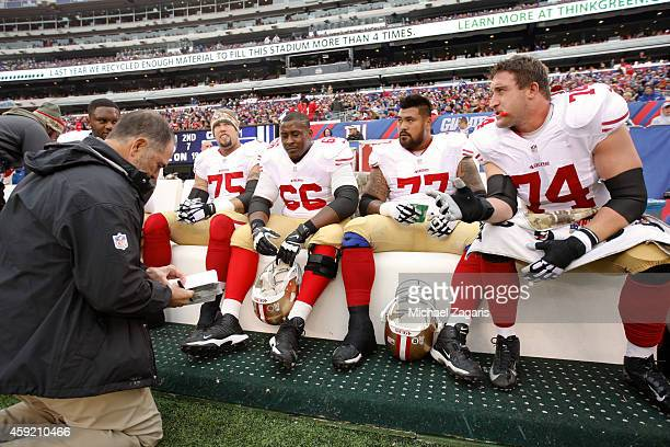Offensive Line Coach Mike Solari of the San Francisco 49ers talks with Alex Boone Marcus Martin Mike Iupati and Joe Staley during the game against...