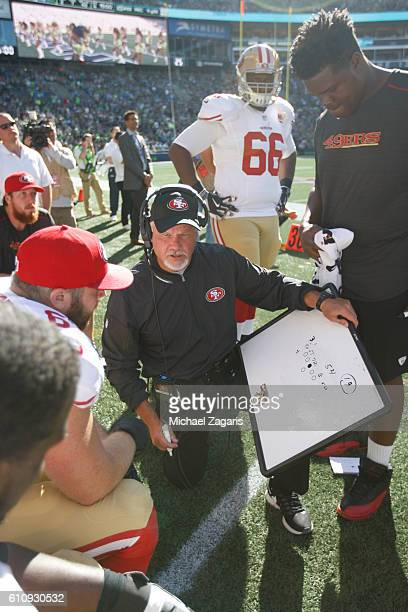 Offensive Line Coach Pat Flaherty of the San Francisco 49ers talks with the offensive line during the game against the Seattle Seahawks at...