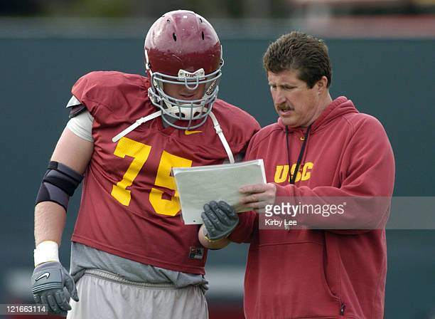 Offensive line coach Pat Ruel and tackle Kyle Williams during spring football practice at Howard Jones Field on the campus of the University of...