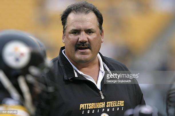 Offensive line coach Russ Grimm of the Pittsburgh Steelers talks to a player before the start of a preseason game against the Philadelphia Eagles at...