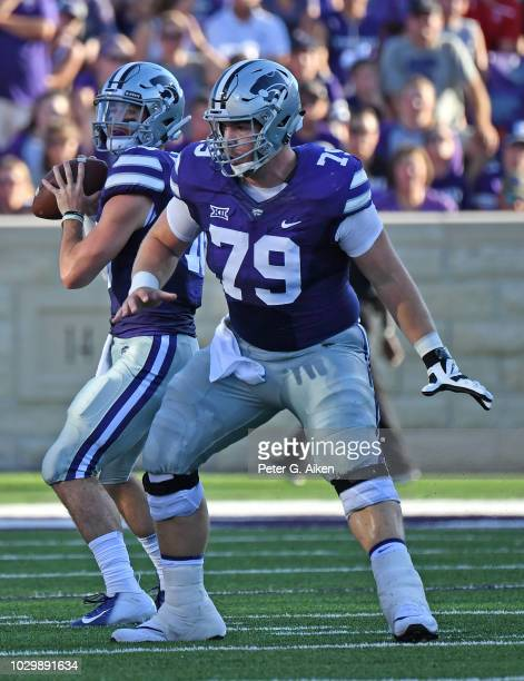 Offensive lineman Adam Holtorf of the Kansas State Wildcats gets set to pass block for quarterback Skylar Thompson of the Kansas State Wildcats...