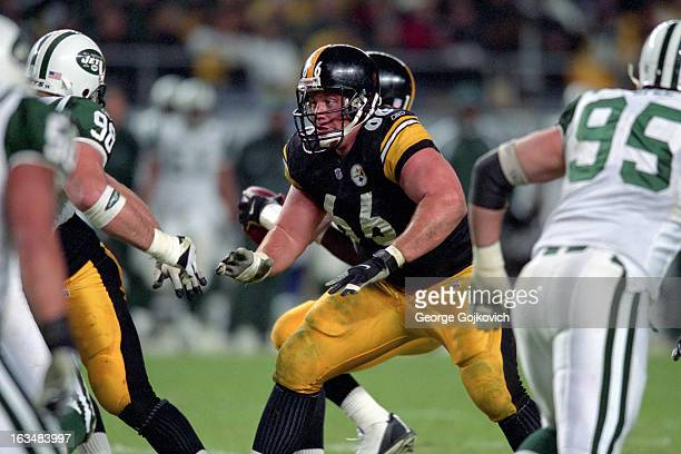 Offensive lineman Alan Faneca of the Pittsburgh Steelers blocks during a game against the New York Jets at Heinz Field on December 9 2001 in...