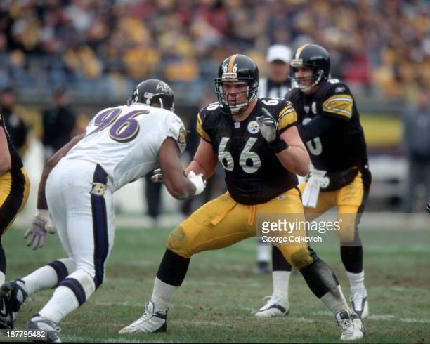 Offensive lineman Alan Faneca of the Pittsburgh Steelers blocks against Adalius Thomas of the Baltimore Ravens at Heinz Field on December 29 2002 in...