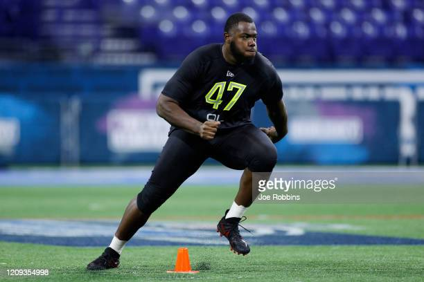 Offensive lineman Andrew Thomas of Georgia runs a drill during the NFL Combine at Lucas Oil Stadium on February 28, 2020 in Indianapolis, Indiana.