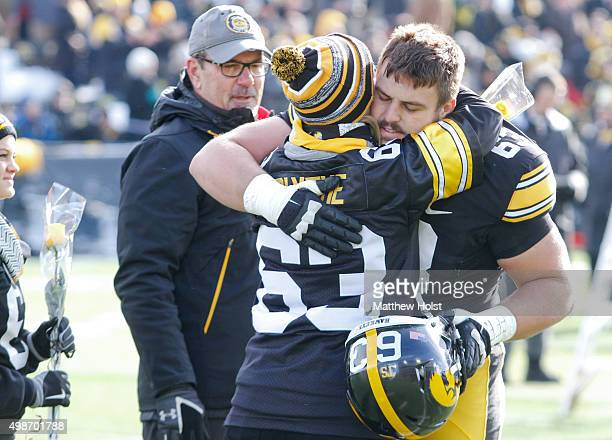 Offensive lineman Austin Blythe of the Iowa Hawkeyes greets family members during senior recognition before the matchup against the Purdue...