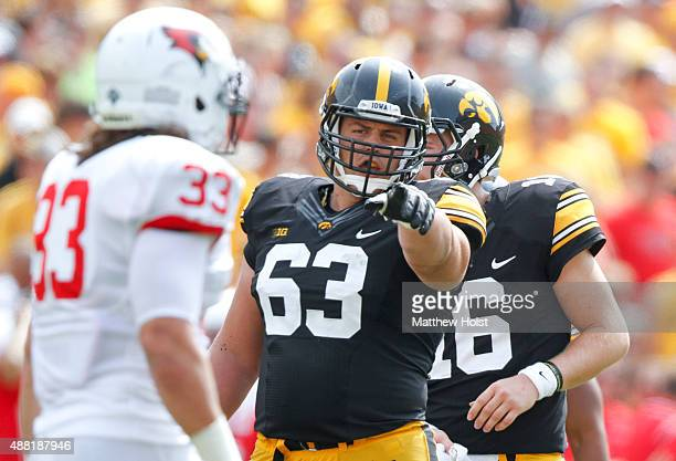 Offensive lineman Austin Blythe of the Iowa Hawkeyes points in the third quarter against the Illinois State Redbirds on September 5 2015 at Kinnick...