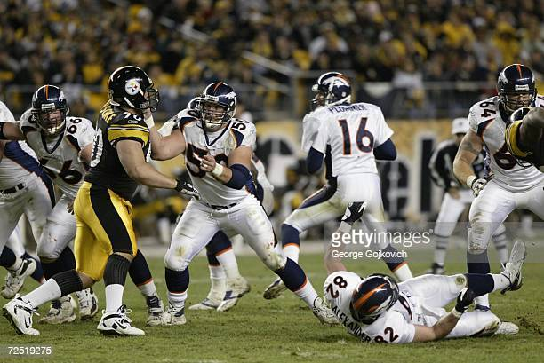 Offensive lineman Ben Hamilton of the Denver Broncos blocks against defensive lineman Travis Kirschke the Pittsburgh Steelers at Heinz Field on...