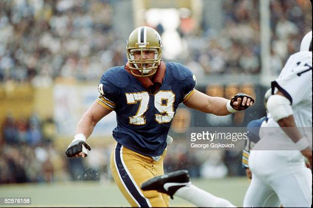 Offensive lineman Bill Fralic of the University of Pittsburgh Panthers looks to block an opponent during a game at Pitt Stadium in 1983 in...