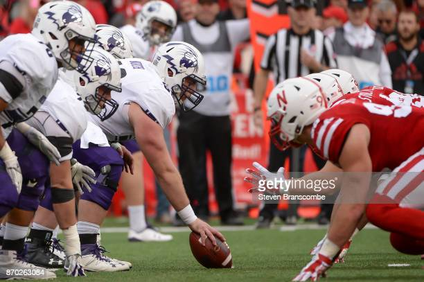 Offensive lineman Brad North of the Northwestern Wildcats prepares to snap the ball against the Nebraska Cornhuskers at Memorial Stadium on November...