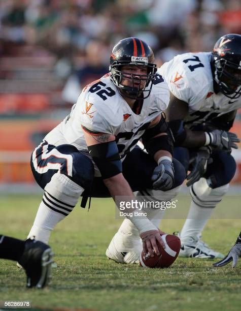 Offensive lineman Brian Barthelmes of the Virginia Cavaliers prepares for the snap against the Miami Hurricanes at the Orange Bowl on November 26,...