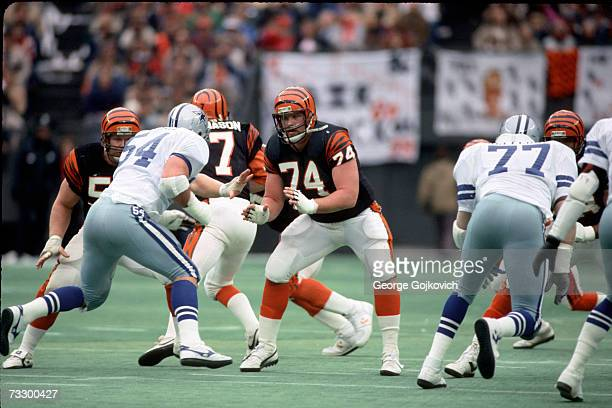 Offensive lineman Brian Blados of the Cincinnati Bengals blocks against Randy White of the Dallas Cowboys at Riverfront Stadium on December 8 1985 in...