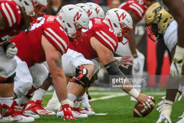 Offensive lineman Cole Conrad of the Nebraska Cornhuskers prepares to snap the ball against the Purdue Boilermakers at Memorial Stadium on September...