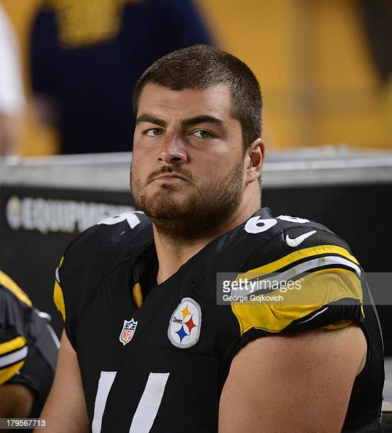Offensive lineman David DeCastro of the Pittsburgh Steelers looks on from the sideline during a preseason game against the New York Giants at Heinz...