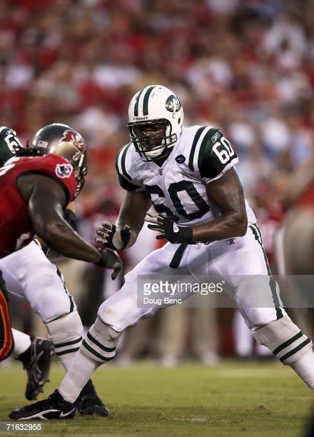 Offensive lineman D'Brickashaw Ferguson of the New York Jets blocks on the line of scrimmage against the Tampa Bay Buccaneers at Raymond James...