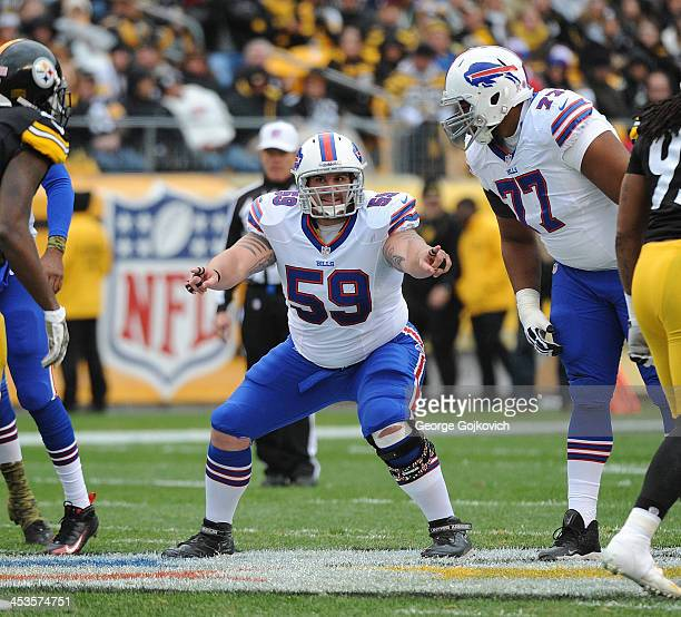 Offensive lineman Doug Legursky of the Buffalo Bills signals from the line of scrimmage as Cordy Glenn looks on during a game against the Pittsburgh...