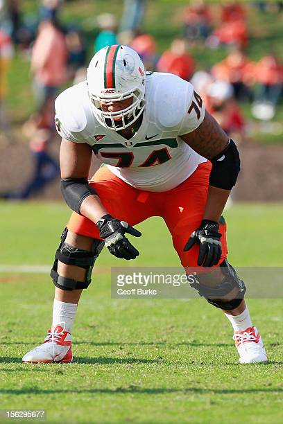 Offensive lineman Ereck Flowers of the Miami Hurricanes lines up against the Virginia Cavaliers at Scott Stadium on November 10, 2012 in...