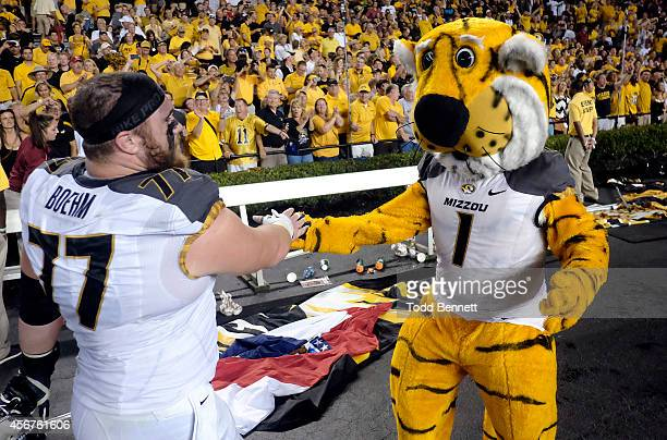 Offensive lineman Evan Boehm of the Missouri Tigers celebrates with mascot Truman after the game against the South Carolina Gamecocks on September 27...