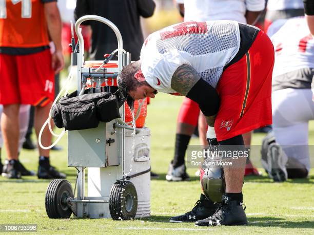 Offensive Lineman Evan Smith of the Tampa Bay Buccaneers tries to cool down with a water bath during Training Camp at One Buc Place on July 28 2018...