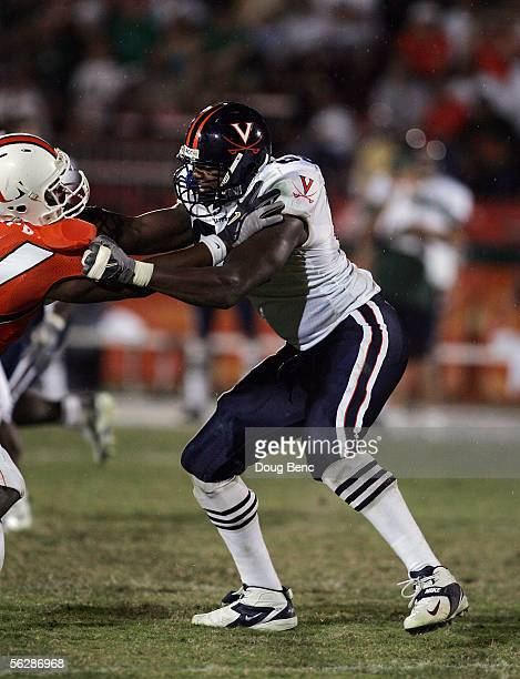 Offensive lineman Ferguson D'Brickashaw of the Virginia Cavaliers blocks against the Miami Hurricanes at the Orange Bowl on November 26, 2005 in...