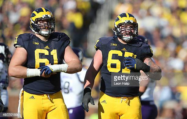 Offensive lineman Graham Glasgow Kyle Kalis of the Michigan Wolverines look to the sidelines during the second quarter of the game against the...