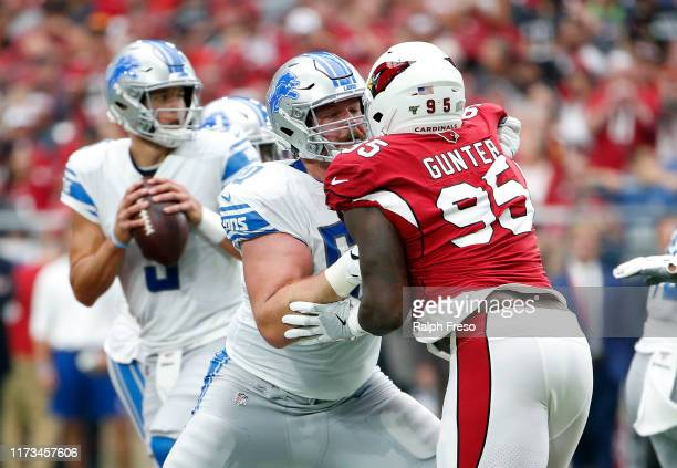 Offensive lineman Graham Glasgow of the Detroit Lions blocks Rodney Gunter of the Arizona Cardinals during the first half of the NFL football game at...