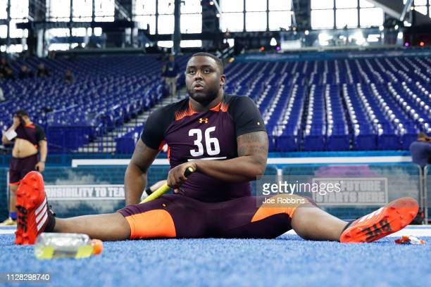 Offensive lineman Greg Little of Ole Miss stretches prior to running the 40yard dash during day two of the NFL Combine at Lucas Oil Stadium on March...
