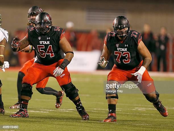 Offensive lineman Isaac Asiata and offensive lineman Jeremiah Poutasi of the Utah Utes look to block against the Oregon Ducks during the first half...