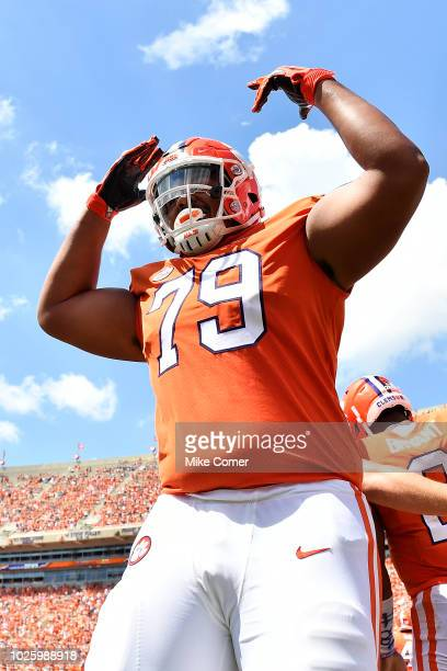Offensive lineman Jackson Carman of the Clemson Tigers celebrates after a touchdown in the third quarter of the Tigers' football game against the...