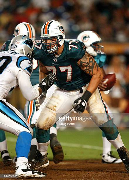 Offensive lineman Jake Long of the Miami Dolphins drops back to block against the Carolina Panthers during a preseason game at Land Shark Stadium on...