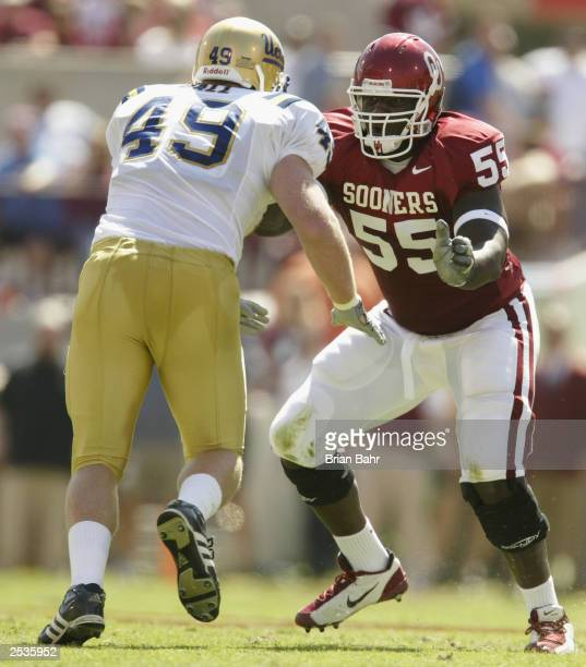 Offensive lineman Jammal Brown of the University of Oklahoma Sooners tries to stop defensive end Mat Ball of the University of California Los Angeles...