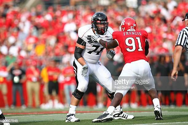 Offensive lineman Jeff Linkenbach of the University of Cincinnati Bearcats blocks against the Rutgers University Scarlett Knights on September 7 2009...