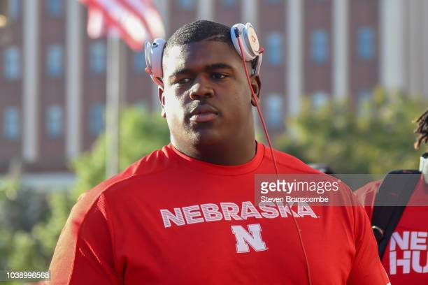 Offensive lineman Jerald Foster of the Nebraska Cornhuskers walks to the stadium before the game against the Troy Trojans at Memorial Stadium on...