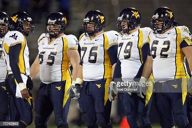 Offensive lineman Jeremy Sheffey Dan Mozes Greg Isdaner and Ryan Stanchek and quarterback Patrick White of the West Virginia University Mountaineers...