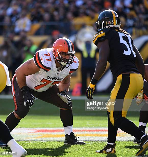 Offensive lineman John Greco of the Cleveland Browns looks across the line of scrimmage at linebacker Sean Spence of the Pittsburgh Steelers during a...