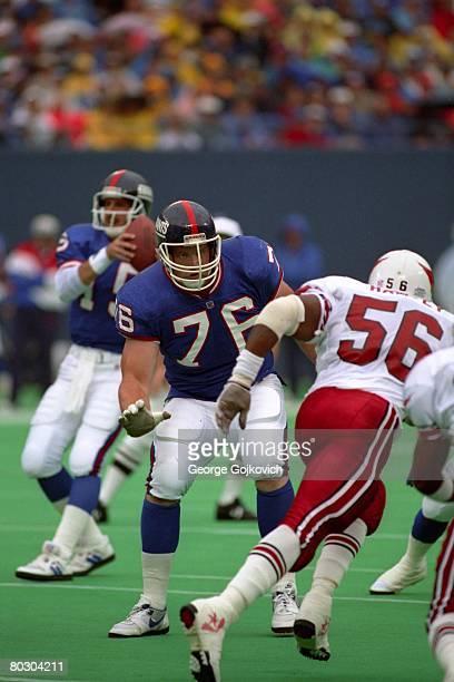 Offensive lineman Jumbo Elliott of the New York Giants blocks against linebacker Ken Harvey of the Phoenix Cardinals at Giants Stadium on October 11...