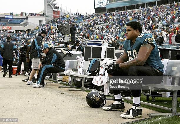 Offensive lineman Khalif Barnes of the Jacksonville Jaguars sits on the end of the bench after losing to the New England Patriots on December 24 2006...