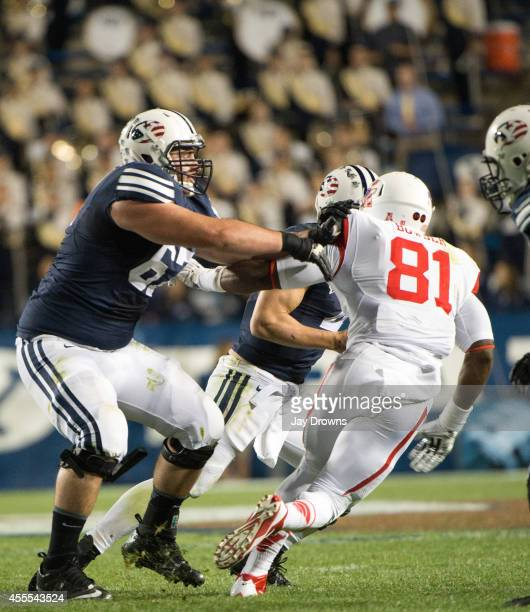 Offensive Lineman Kyle Johnson of the BYU Cougars blocks defensive end Tyus Bowser of the Houston Cougars on September 11 2014 at LaVell Edwards...