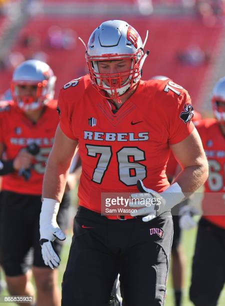 Offensive lineman Kyle Saxelid of the UNLV Rebels warms up before the team's game against the Utah State Aggies at Sam Boyd Stadium on October 21...