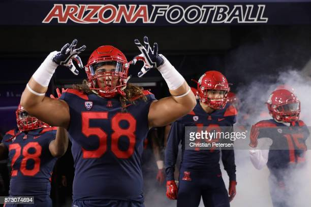Offensive lineman Layth Friekh of the Arizona Wildcats prepares to take the field with teammates before the college football game against the Oregon...
